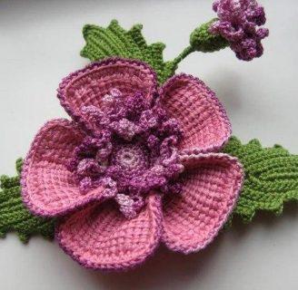 como hacer flores de lana con dos agujas para adornar